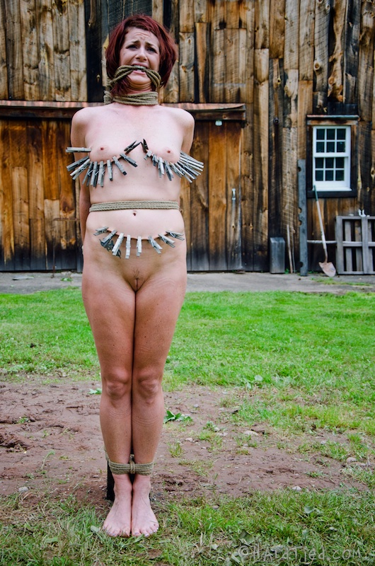 Naked women bound outdoors