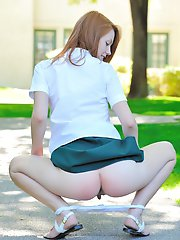Redhead Shoolgirl Shows Her Pussy Outdoor